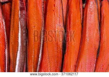 Close Up View Of Lot Fillet Salted Cold Smoked Red Fish King Salmon. Prepared And Ready-to-eat Pacif