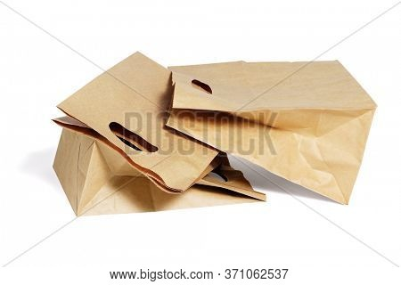 Three Brown Paper Bags Lying on White Background