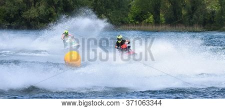 Jet Ski  Race Competitor Cornering At Speed Creating At Lot Of Spray.