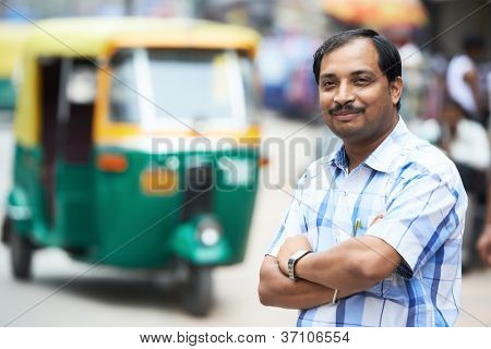 Indian auto rickshaw three-weeler tuk-tuk taxi driver man