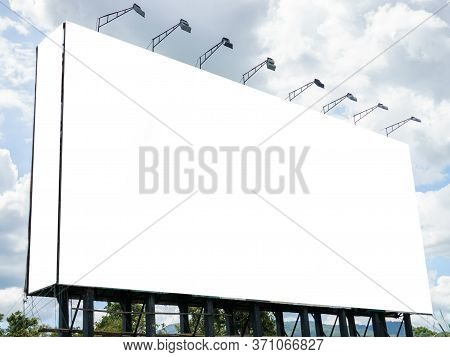 Advertising Concept, Blank Template Outdoor For Advertising Or Blank Billboard On Sky With Cloud.