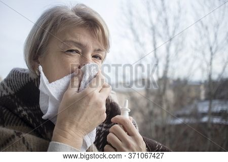 Sick Ill Senior Mature Woman Drips, Injecting Nasal Drop For Blocked Nose. Retired Female With Runny