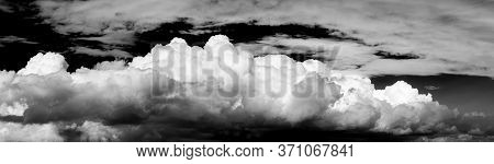 Black And White Panoramic View Of Puffy White Clouds During A Beautiful Sunny Day. Taken Over Vancou