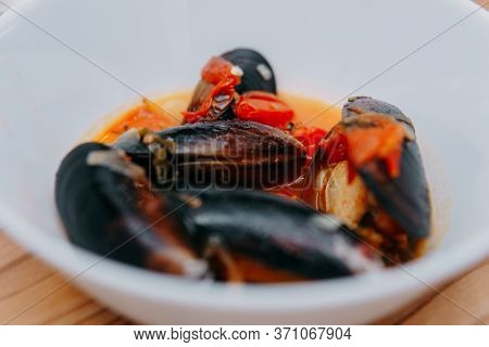 Tomato Soup With Mussels. The Process Of Cooking Tomato Soup From Mussels In A Cooking Class. Home-m