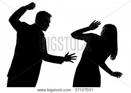 one caucasian couple man and woman expressing domestic violence in studio silhouette isolated on white background
