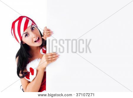 young woman dressed as Santa with big tablet, isolated against white background