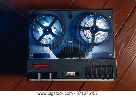 reel to reel audio tape recorder with blue led light strip. VU meter with