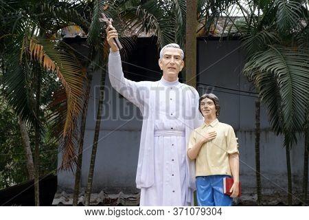 KUMROKHALI, INDIA - FEBRUARY 24, 2020: Monument to Croatian Jesuit Missionary Ante Gabric in front of the Catholic Church in Kumrokhali, West Bengal, India