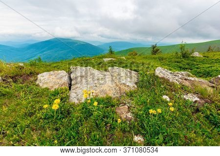 Boulders On The Alpine Hillside. View From The Edge Of A Hill. Beautiful Summer Landscape In Mountai