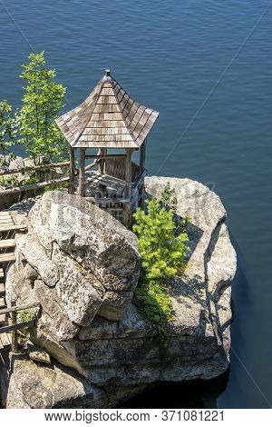 Wooden Gazebo On A Boulder On Mohonk Lake, In Upstate New York