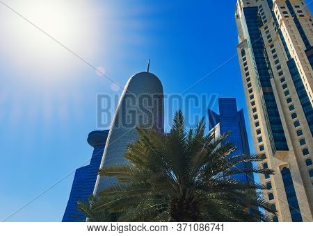 Skyscrapers And Towers Of Doha With Sunbeam. Futuristic Skyline Of Financial Commercial Qatar Distri