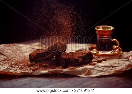 Delicious Homemade Chocolate Brownies And Cup Of Coffee Composition On Dark Background. Chocolate Ba