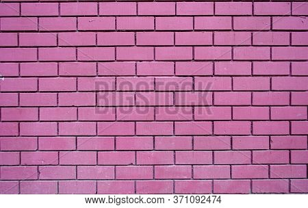Fuchsia Brick Wall Texture Background Material Construction. Wall Made Of Smooth Pink Decorative Bri
