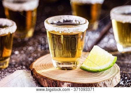 Several Glasses Of Tequila, A Traditional Mexican Drink. International Tequila Day Celebrated On Jul
