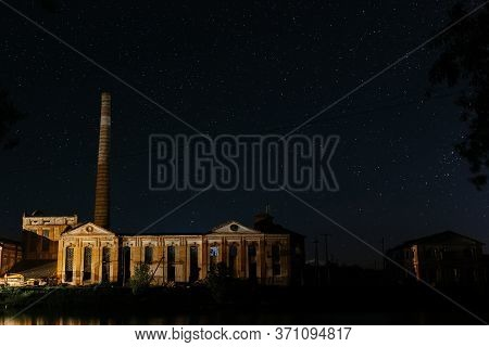Old Factory With High High Pipe On The Background Of The Starry Night. Starry Night