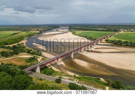 Santarem, Portugal. Ponte Dom Luis I Bridge, Tagus River and Leziria fields the fertile alluvial plain of Ribatejo. Seen from Portas do Sol viewpoint