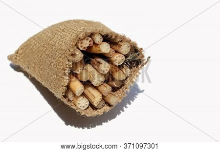 Lotus Rhizome Or Roots Vegetable In Jute Sack Isolated On White Background With Copy Space For Texts