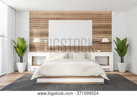 Interior Of Stylish Master Bedroom With White And Wooden Walls, Wooden Floor, Comfortable King Size