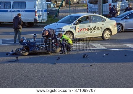 Saint Petersburg, Russia - June 2019: A Motobike Crashed Into A Car A Motorcyclist Was Injured Polic