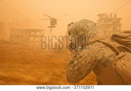 Military Helicopter And Forces In Destroyed City And A Soldier Protects The Soldiers That Roping Hel