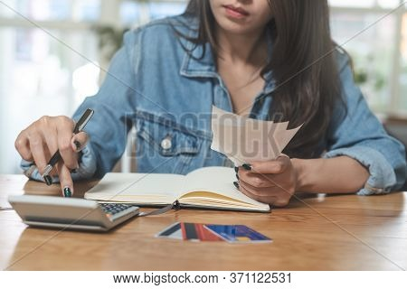 Woman Doing Accounting Home Finance Expenses And Calculate Credit Card Monthly Debt To Bills Payment