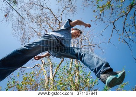 Man Jumping Or Crossing Step Over In Forest