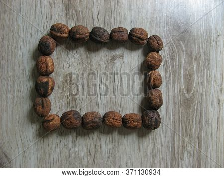 Square Box With Walnuts On Wooden Background. Walnuts Is A Healthy Vegetarian Protein Nutritious Foo