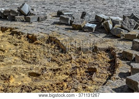 Disassembled Paving Granite Stones. Repair Of Paving Slabs On The Surface Of Sidewalks And Squares,