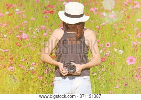 Chiangrai, Thailand - December 7, 2016: Hipster Girl Holding Nikon Dslr Camera And Standing With Ora
