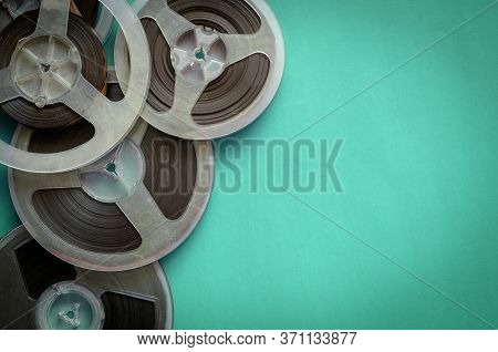 Reels With A Magnetic Tape On Turquoise. Random Bobbins With Audio Recordings. Nostalgia, Pleasant M
