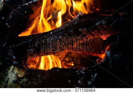 Bonfire Orange Flame Of Fire. Bonfire Is Close. Fire In The Nature. Bonfire Background.