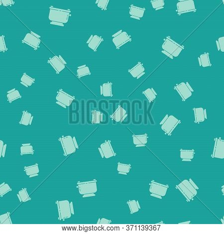 Green Toaster With Toasts Icon Isolated Seamless Pattern On Green Background. Vector