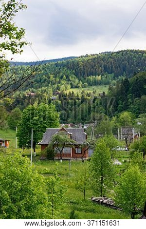 Village in Carpathian Mountains. Yaremche eco-resort in Ukraine, summer. Rural scene, an ideal place to escape from the hustle and bustle of the city.