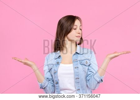 Pretty Smiling Girl Student Dressed In White T-shirt, Denim Jacket Is Standing On Pink Background. Y
