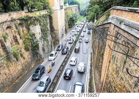 Top View Of A Busy Street In The Ancient City Of Rome, Italy - Street Is Full Of Cars And Scooters -