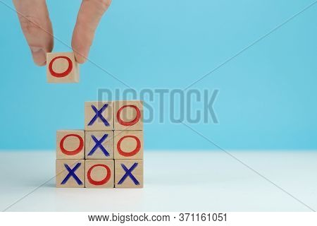 Business Marketing Strategy Planning Concept. Wooden Block Tic Tac Toe Board Game