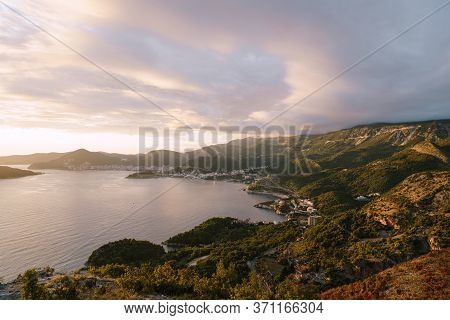 Budvan Coast. Mountains And Cities Along The Road On The Adriatic Coast In Montenegro, At Sunset.