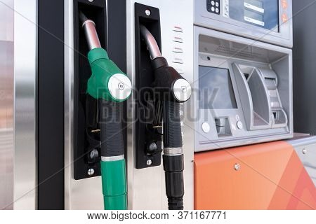 Fuel Pumps. Diesel And Gasoline Pistol On Self Service Petrol Pump