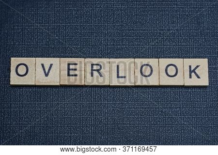 Text On Word Overlook From Gray Wooden Letters On A Black Background