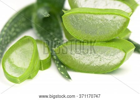 Closed Up Of Cut Aloe Vera Leaves Background. Slice Aloe Vera (aloe Barbadensis Mill.,star Cactus, A