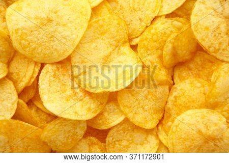 Prepared Golden Potato Chips Background. Top View