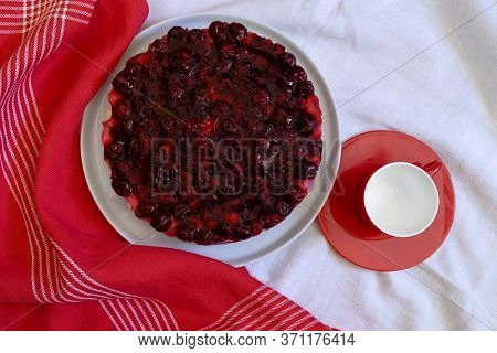 Homemade No Baked Cake With Mascarpone Cheese Cream, Fresh Cherries And Jelly  On A White Plate,  Re