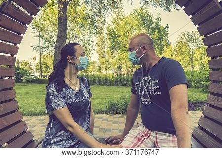 Happy Couple In Love Wearing Medical Mask To Protect From Coronavirus. Park Outdoors, Coronavirus Qu