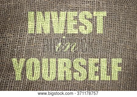 Invest In Yourself .words Printed On Burlap Canvas. Business And Career Concept For Self Motivation