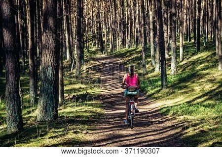 Wolin Island, Poland - June 28, 2019: Woman Rides Bike In Wolin National Park On Wolin - Baltic Sea