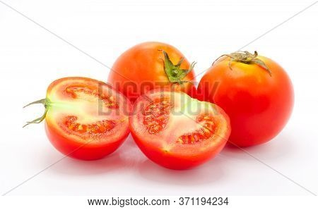 Tomatoes. And A Half Tomato Isolated On White