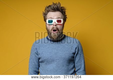 Shaggy, Bearded Man With 3d Glasses And An Old Sweater, With A Surprised Expression On Face And Open