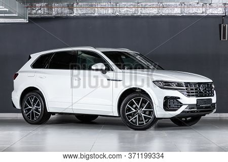 Novosibirsk/ Russia - March 15, 2020: White Volkswagen Touareg, Expensive Crossover  Car Parked On B