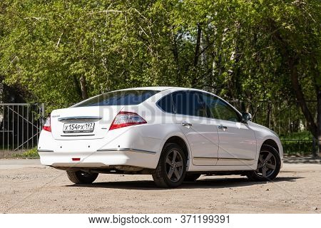 Novosibirsk/ Russia - May 22, 2020: White Nissan Teana, Expensive  Sedan  Car Parked Outdoors On A W