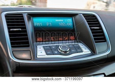 Novosibirsk/ Russia - May 22, 2020: Nissan Teana, A Close Up On A Black Panel With Radio,  Player An